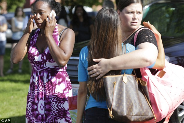 Students comforted each other as they frantically tried to get in touch with loved ones following the chaos of the shooting