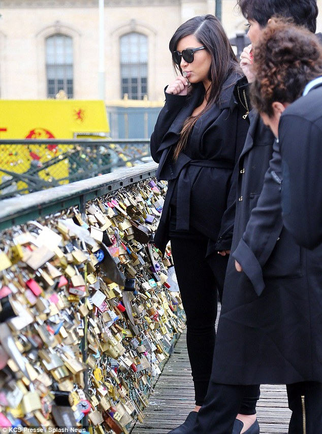 Kim Kardashian and mother at Pont des Arts attaching love lock to the bridge