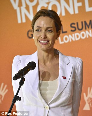 """Mandatory Credit: Photo by Ray Tang/REX (3805859f)<br />  Angelina Jolie<br />  Global Summit on Ending Sexual Violence in Conflict, ExCeL London, Britain – 10 Jun 2014″ width=""""306″ height=""""385″ /></div> </div> <p class="""