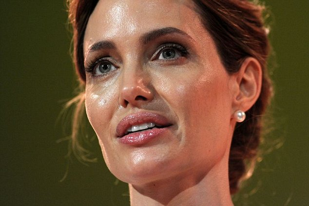 US actress and UN special envoy Angelina Jolie makes the opening speech at the start of the  Global Summit to End Sexual Violence in Conflict in  London Tuesday June 10, 2014  They are hosting a four-day summit on sexual violence in war zones, attended by officials from over 100 countries. The summit, starting Tuesday, aims to identify ways to improve investigation of sexual violence and provide support for women and girls. (AP Photo/Carl Court, Pool)