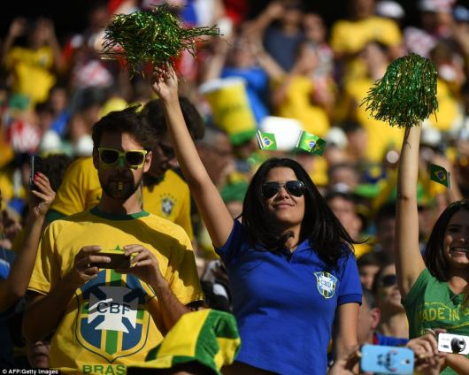 Brazilian fans cheer during the World Cup opening ceremony as they prepare to watch their team kick off the month-long football tournament with the opening Group A match against Croatia