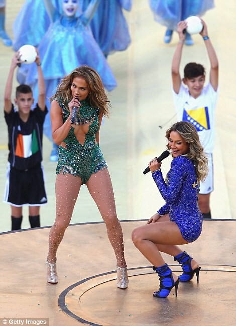 Joining her on stage: Brazilian pop singer Cláudia Leitte also gave J-Lo a run for her money in the booty-shakin' department as they danced together throughout the performance