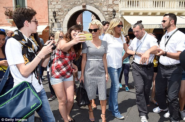 Always time for a selfie: Pammy treated some of her fans to a cute snap as she wandered around the town on Monday morning