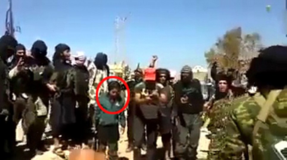 Sickening: The baying mob celebrate as the man is executed with a gunshot to the back of the head in the latest disturbing video to emerge from Iraq