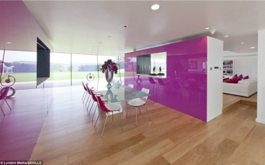 Dining room: The family of four dine in this minimal, purple-and-white-themed room which is separated from the living room with a free-standing wall
