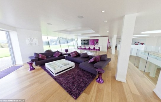Open space: This living space and kitchen area, complete with a breakfast bar, is set in the space above the 100ft hall way