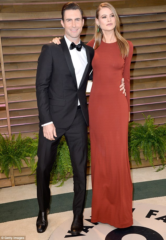 The future Mr and Mrs Levine: Adam and Behati, who make a striking couple, are due to marry on the beach in Mexico on July 19