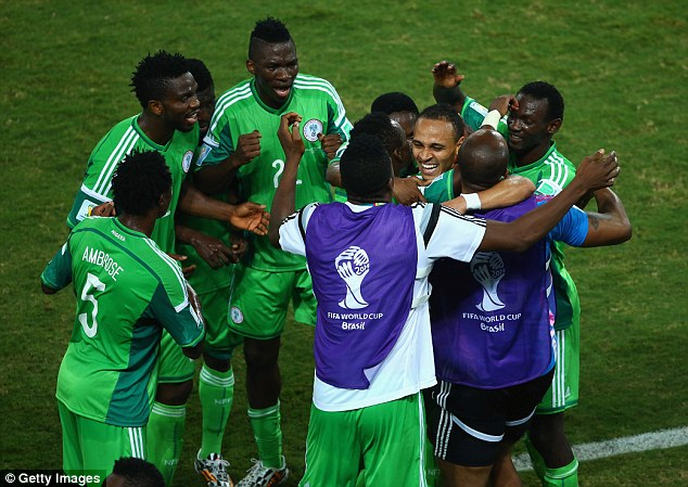 Centre of attention: Odemwingie is hugged by his team-mates and substitutes after finding the net