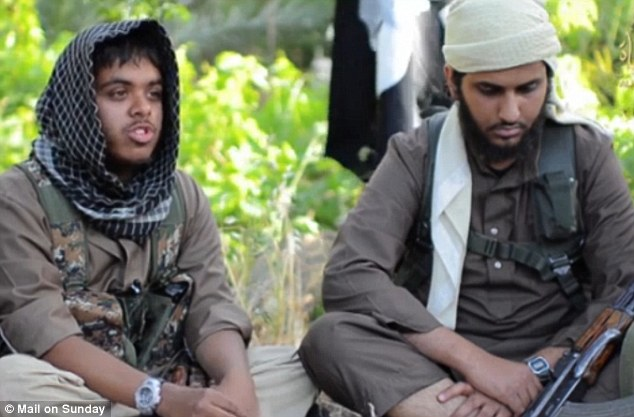 From Wales to a warzone: Reyaad Khan (left) sits alongside fNasser Muthana, with a rifle resting on his knee, urging Britons to travel to Iraq and Syria