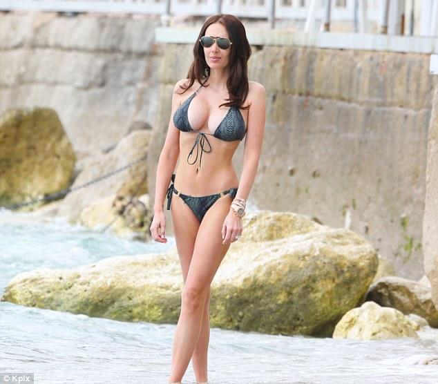 Brunette beauty: Tamara looked incredible in a two-piece snakeskin bikini which enabled her to showcase her toned tum