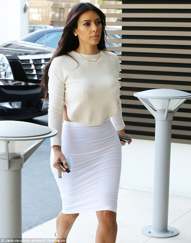 Back to normal! Kim proved she's got bra-vado as she confidently arrived in LA wearing a backless ensemble ready for a day of shopping
