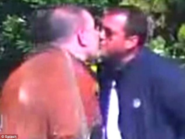 Two suspected mob bosses kiss each other in a show of loyalty. The image comes from surveillance footage from the operation released by Italian police