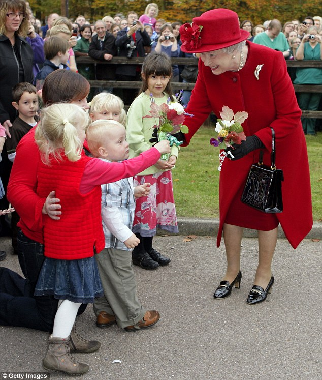 In 2009, pictured, Her Majesty added contrast to the blaze of red to greet wellwishers in Newmarket