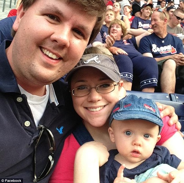 Happy family? Justin Ross Harris pictured with wife Leanna and son Cooper. The couple had both a $2,000 and a $25,000 life insurance policy on their son