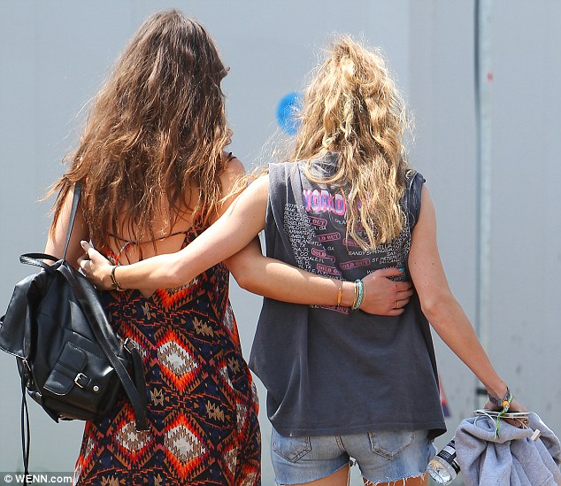 Hanging out: Harry's ex was joined by a pal who she wrapped her arms around