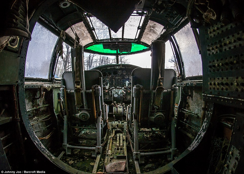 The once gleaming cockpit of a fighter plane gather moss and rust. Mr Soplata was moved to rescue the planes through his work at the scrapyard