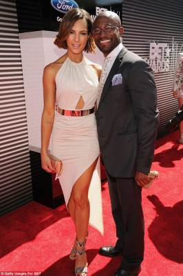 It's official: Taye Diggs made his first red carpet appearance with new girlfriend Amanza Smith Brown at the BET Awards in LA on Sunday