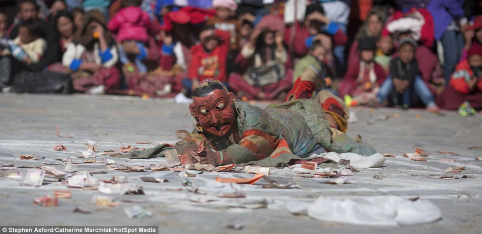Money talks: A performer represents greed for money at the annual Torgya Festival in Tawang, in north-eastern India