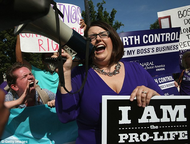 Protesters from both sides of the birth control issue Leah Hughs, left, and Students for Life President Kristin Hawkins, right, chant for their side in front of the Supreme Court this morning