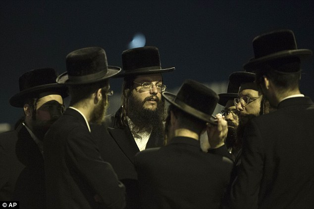Not coming home: Orthodox Jews, family and friends of Israeli Eyal Yifrah, gather outside of his home on Monday