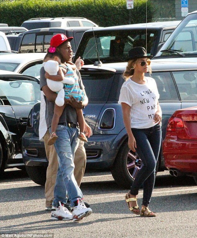 On the rocks?: Beyonce - pictured in The Hamptons with husband Jay Z and Blue Ivy - has hinted at marriage troubles as she changed the lyrics in a song about cheating during her performance on the couples On The Run tour in Ohio on Saturday