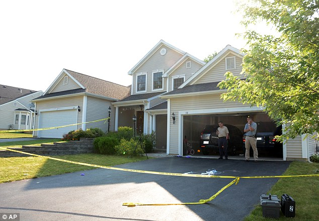 Crime scene: Detectives work at the house in East Greenbush, N.Y. where angela Mtambu and her two daughters, ages 6 and nine, were found dead in a murder-suicide
