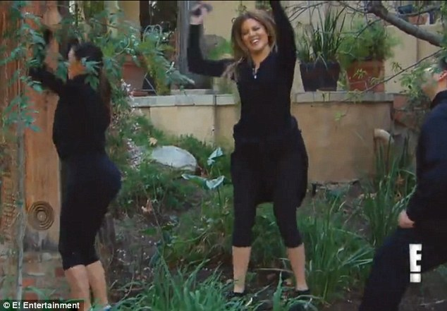 Family workout: In the video the sisters help Rob with his exercise routine