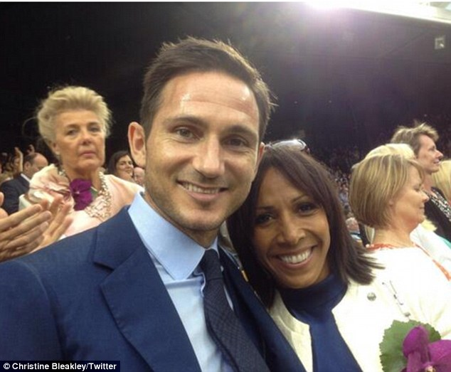 Medallist in their midst: Christine took to her Twitter account to upload a snapshot of her beau posing with Olympian Dame Kelly Holmes