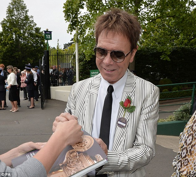 Singing in the rain: Sir Cliff Richard is also in attendance