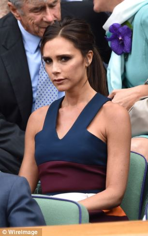 Looking glum: There were no smiles from Victoria Beckham on Sunday as she watched the men's final with husband David from the Royal Box
