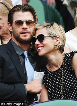 Happy couple: Chris Hemsworth and wife Elsa Pataky looked thrilled to be in each others company as they watched the tennis