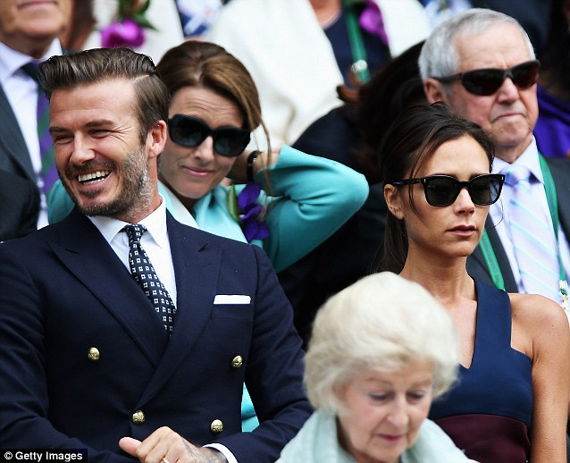 Jovial: David looked like he was having a great time watching the men's final alongside wife Victoria