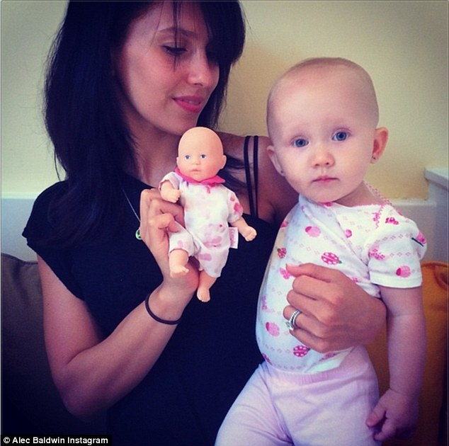 Doting mom: Alec shared this photo with the caption, 'Here at the Carmen Bella Doll Corp test facility, quality control is our highest priority. #carmenthoughts'