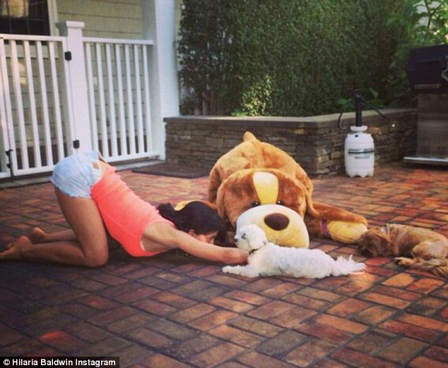 She's gone to the dogs: The budding celebrity posed with her two pooches in early July
