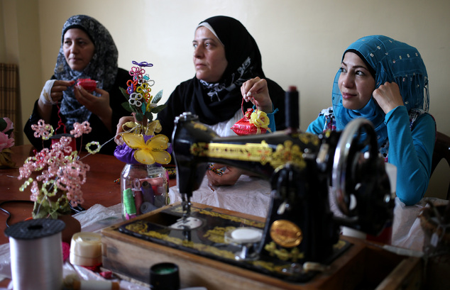 In this photo taken on May 29, 2014, Syrian refugee women attend a handcrafts class where they obtain crucial training to find jobs in a community center in ...