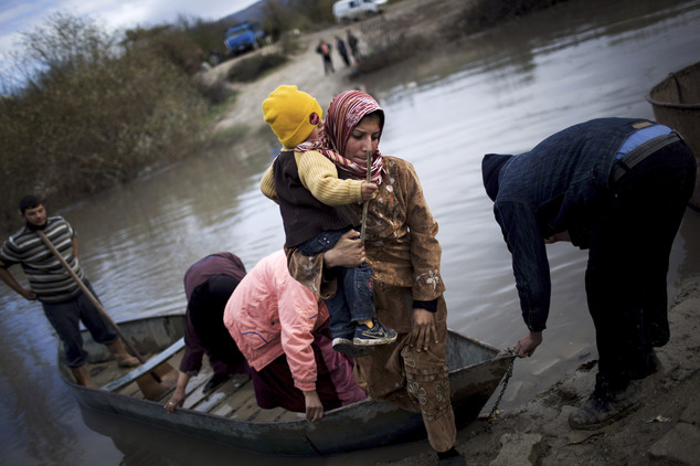 FILE - In this Dec. 8, 2012, file photo, Syrian refugees cross from Syria to Turkey by the Orontes river, near the village of Hacipasa, Turkey. Across the re...