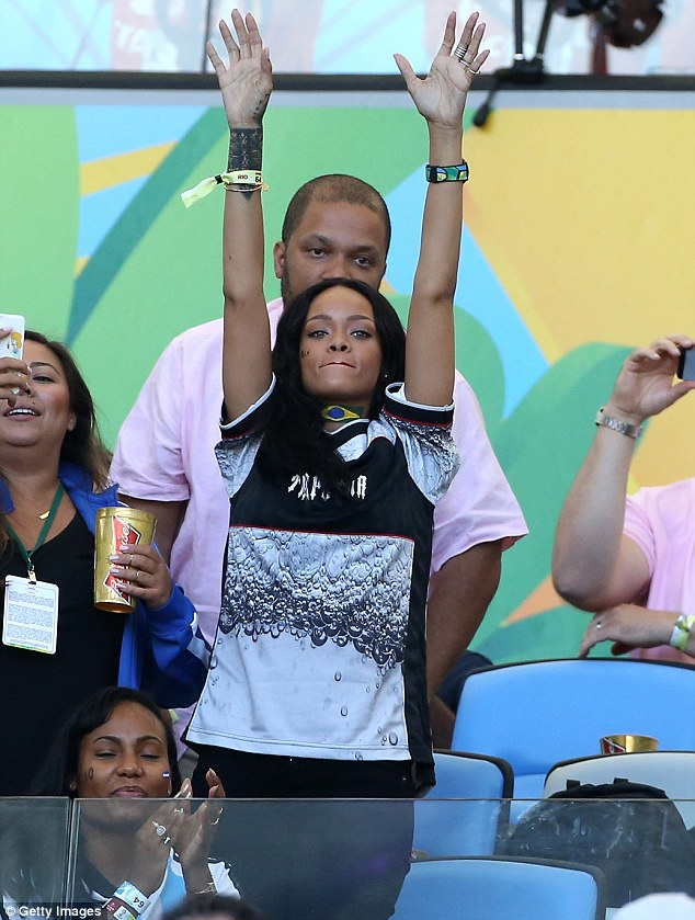 Hands up: Rihanna had her arms up in the air during the game