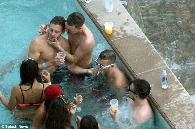 Puffing: Jack Wilshere is pictured smoking on holiday with friends in Las Vegas after the World Cup
