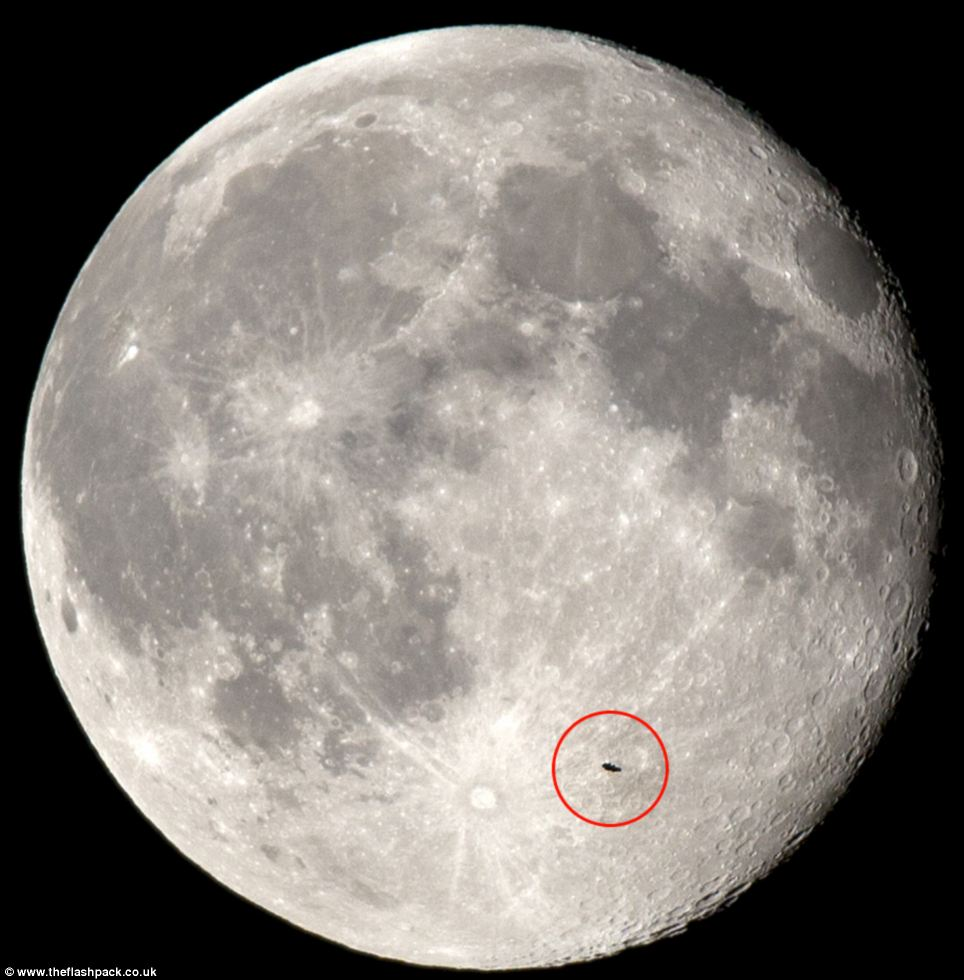 Photographer and Co-founder of group travel company The Flash Pack took these pictures of the moon around 11.30pm BST on Sunday night and was amazed to see a black object (ringed in red) flying from the right side to the left of the moon