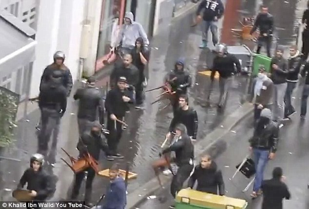 A still taken from the video shows dozens of men in Paris walking down the streets armed with chairs and other weapons, before clashing with pro-Palestinian demonstrators