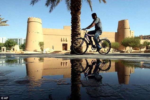 A Saudi man rides his bike in Riyadh, Saudi Arabia, where anyone caught drink-driving faces 800 lashes