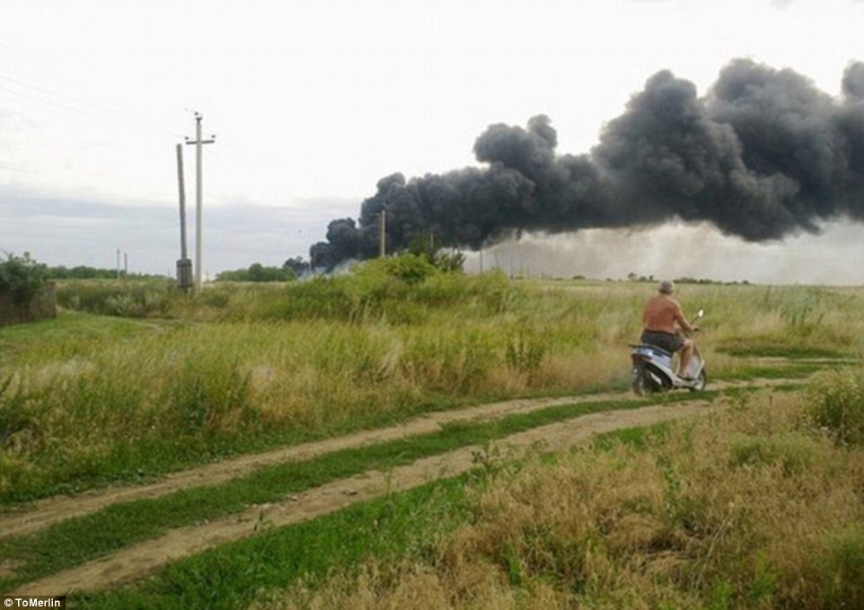 Down: Smoke billows into the sky after a Malaysia Airlines passenger plane was shot out of the sky at 33,000ft over eastern Ukraine, killing all 295 people on board
