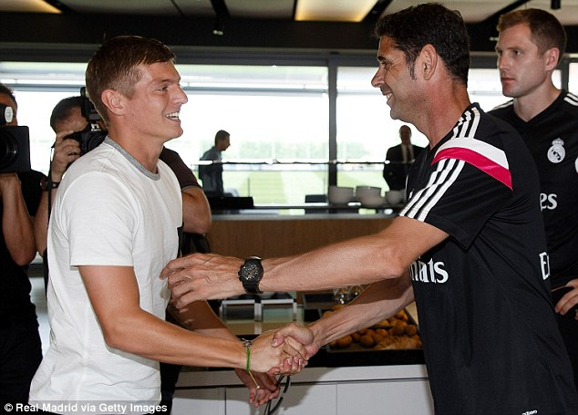 Welcome aboard: Kroos is greeted by  Assistant coach Fernando Hierro