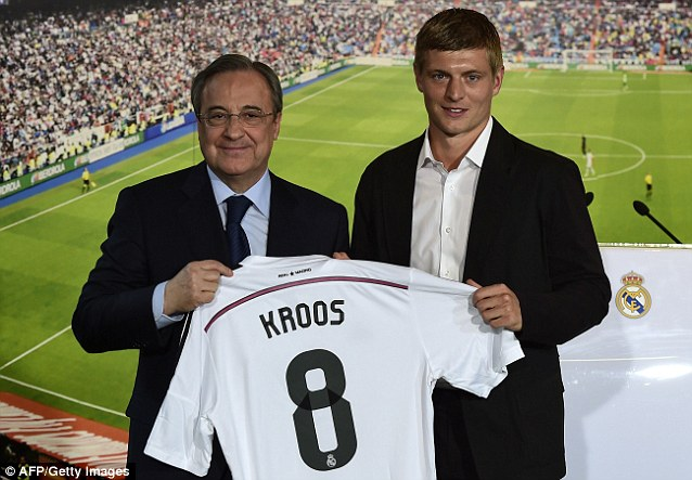Delighted: Real Madrid president Florentino Perez unveils Toni Kroos following his move