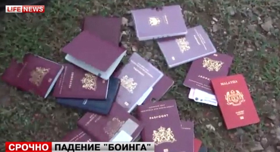 Poignant: Passports of some of the victims. Emergency services rescue worker said at least 100 bodies had so far been found at the scene near the village of Grabovo