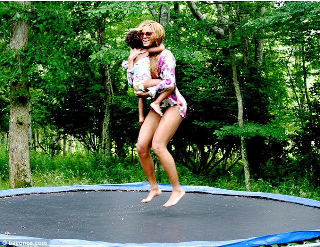 Carefree: Beyonce posted some shots on her Instagram earlier this week giving fans a peek into her idyllic family life. Seen here with daughter Blue Ivy as she bounces on a trampoline