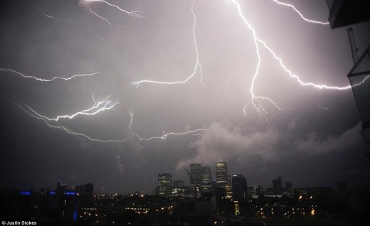 London-based photographer Justin Stokes caught this photo of lightning forking through the sky above Canary Wharf as large parts of the UK saw thunderstorms