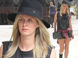 That's some bag, lady! Fashionista Nicky Hilton totes edgy chain-covered Chanel purse as shows off her legs in micro-shorts on stroll