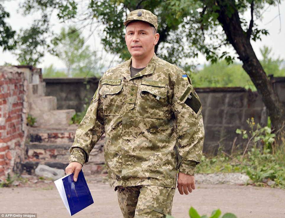 Under pressure: Ukrainian Defense Minister Valeriy Geletey arrives for a meeting with media in Kramatorsk as global demands mounted to find those responsible for downing the airliner