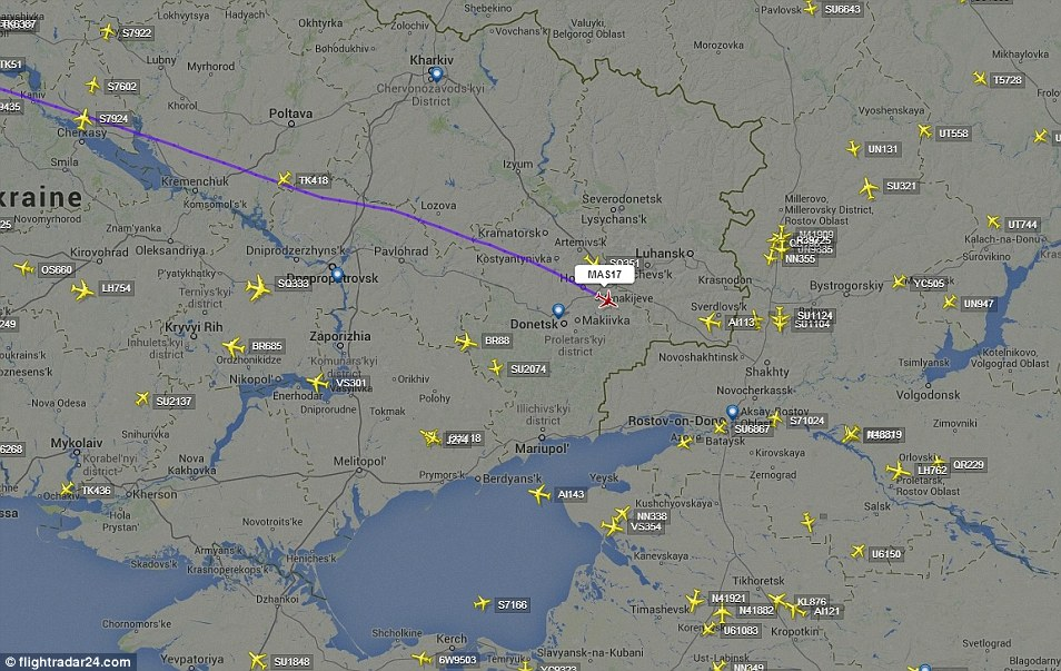 Danger zone: Flightradar24.com data shows the closest plane in the air to MH17 just two minutes before it was shot out of the sky over Ukraine was a Singapore Airlines flight